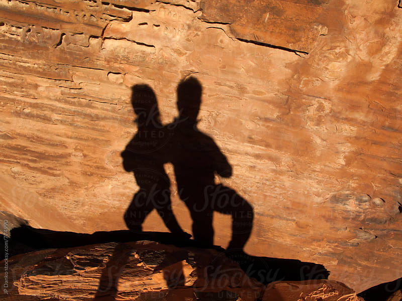 Shadows of Successful Man and Woman Posing Together in Red Rock Canyon Las Vegas Nevada by JP Danko for Stocksy United