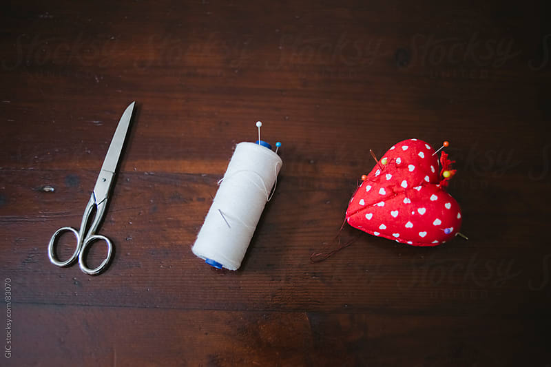 Scissors and sewing thread by GIC for Stocksy United