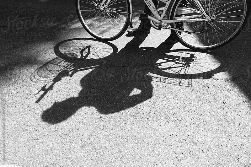 Bike Rider Shadow by Brad and Jen Butcher for Stocksy United