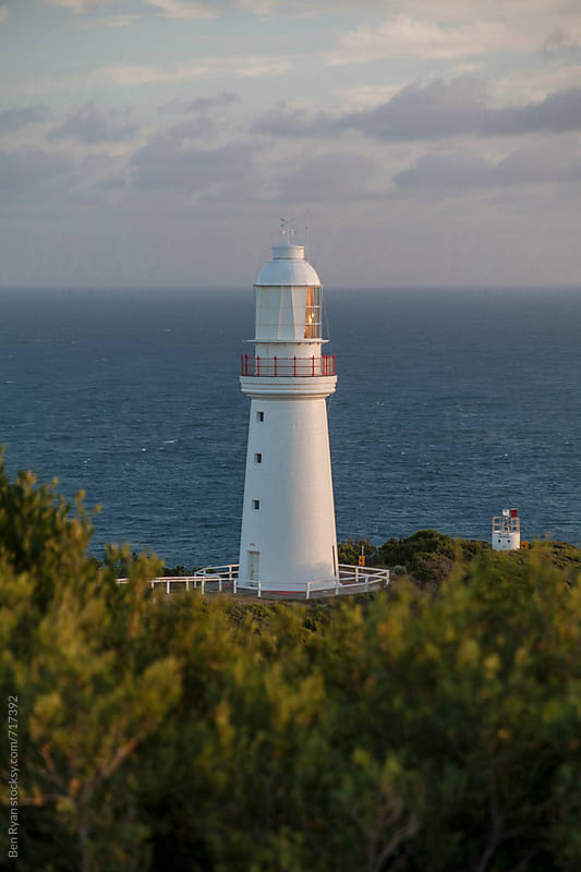 Remote lighthouse with ocean in background by Ben Ryan for Stocksy United