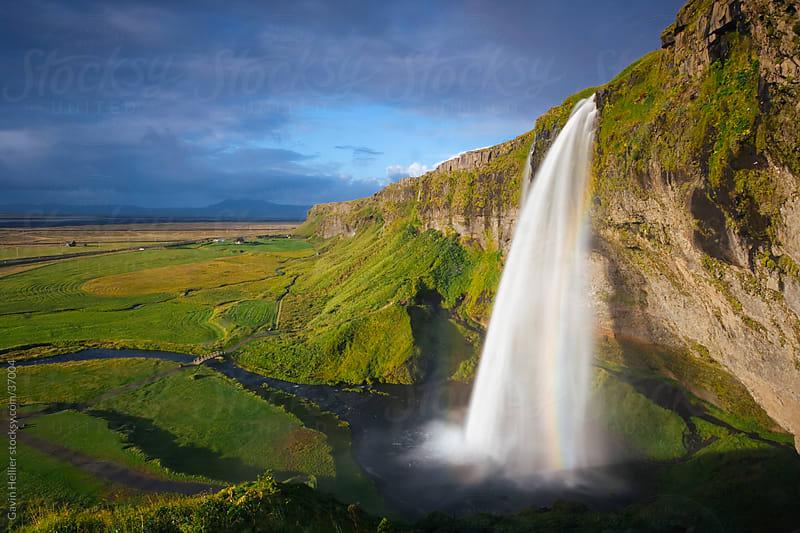 Iceland, Seljalandsfoss, Southern Iceland, Seljalandsfoss waterfall (blurred motion) by Gavin Hellier for Stocksy United