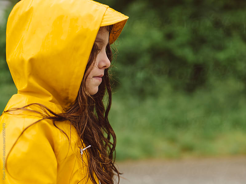 Girl with yellow raincoat. by Dejan Ristovski for Stocksy United