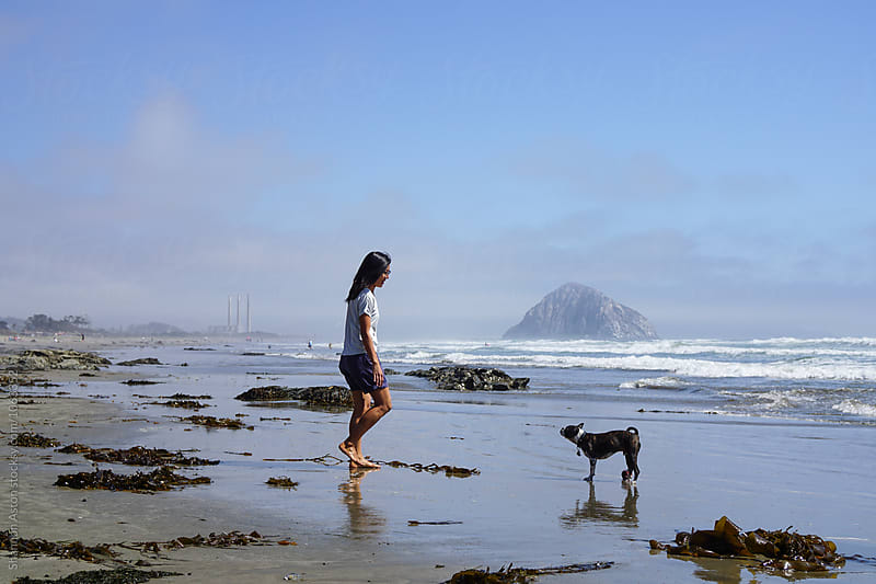 Kathy & Bruce play at Morro Bay by Shannon Aston for Stocksy United