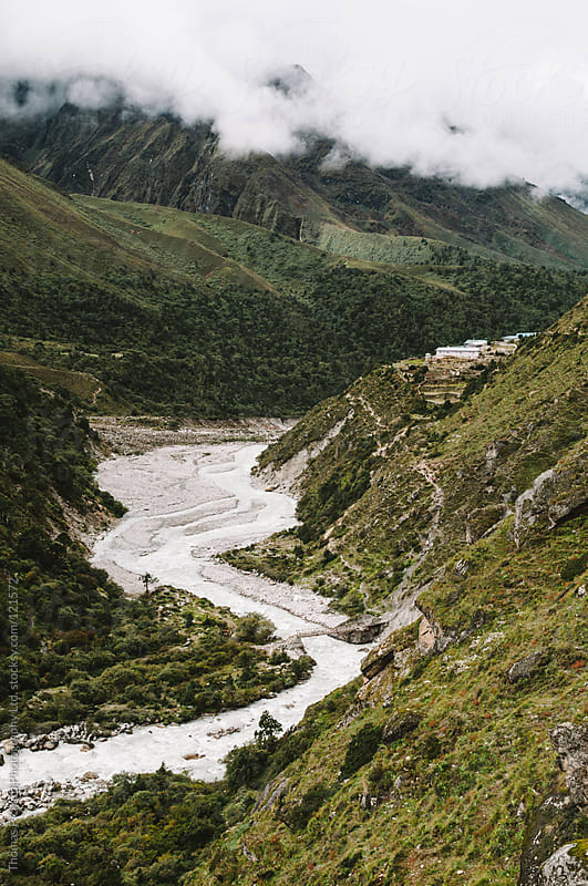 River, valley, village and clouds, Everest Region, Sagarmatha National Park, Nepal. by Thomas Pickard for Stocksy United