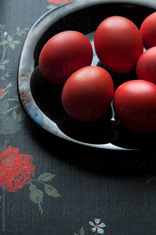 red eggs on black background by Sonja Lekovic for Stocksy United