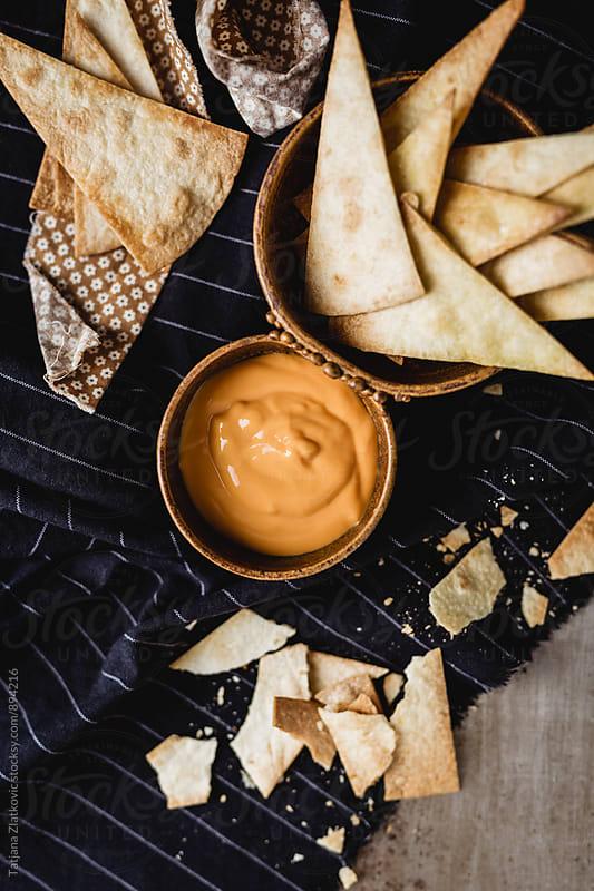Homemade nacho chips with cheese by Tatjana Zlatkovic for Stocksy United