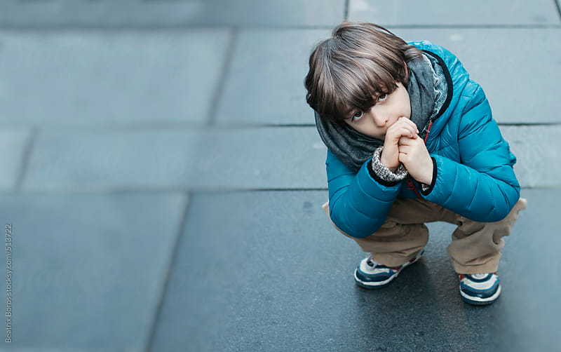 No more walk please: a six years old boy doesn't want to walk any more by Beatrix Boros for Stocksy United