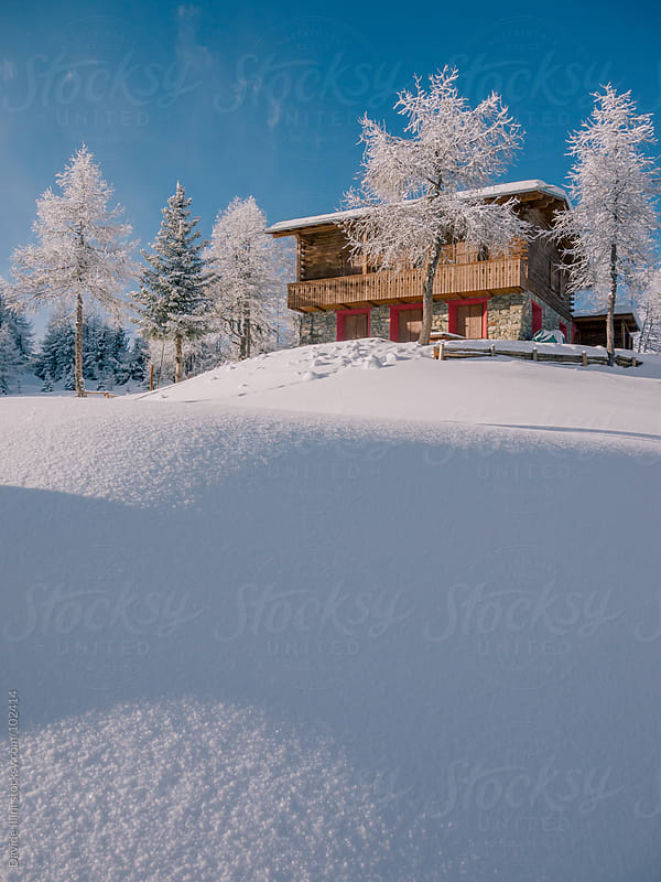 A typical chalet in the alps in winter by Davide Illini for Stocksy United