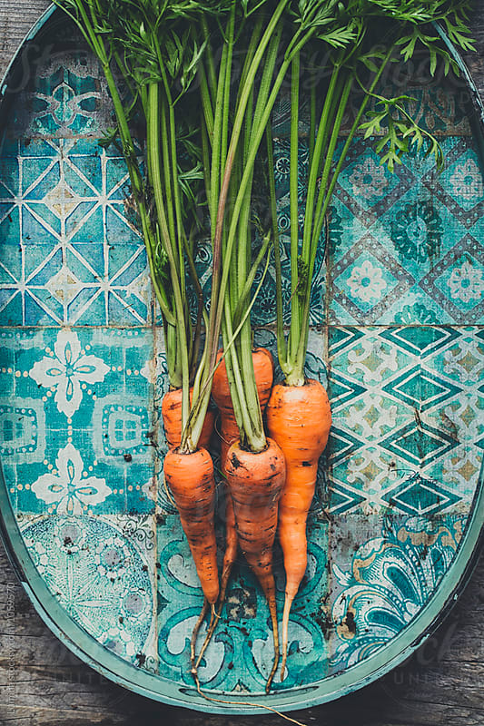 Carrots on a Old Tray by Lumina for Stocksy United