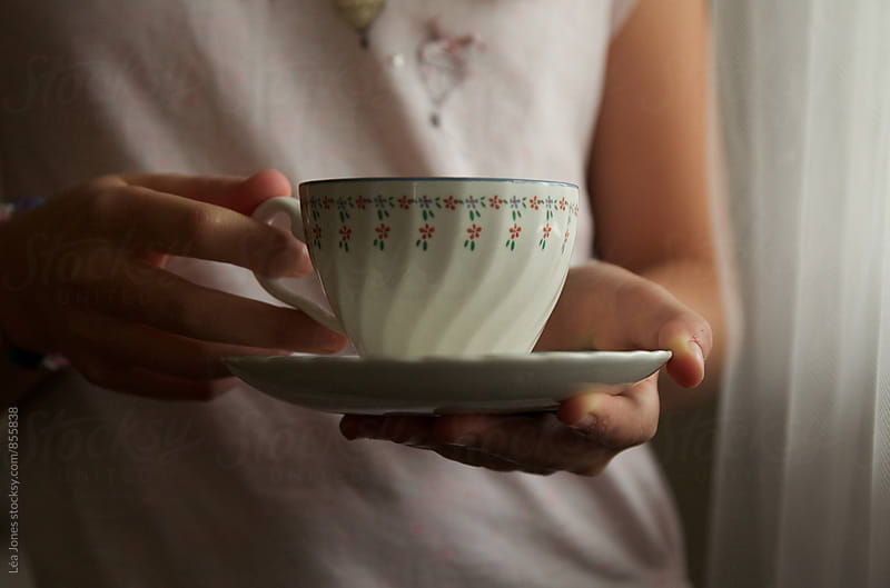 cup of tea in hands by Léa Jones for Stocksy United