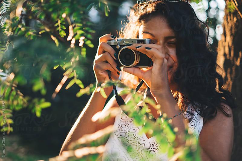 Bolivian Teen Taking Photos in Park by Nemanja Glumac for Stocksy United