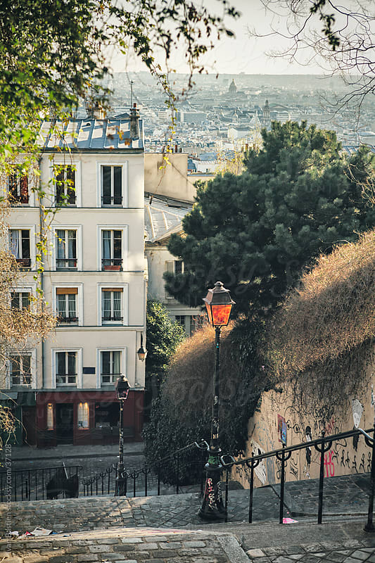 Montmartre stairs and Paris skyline by Ivan Bastien for Stocksy United
