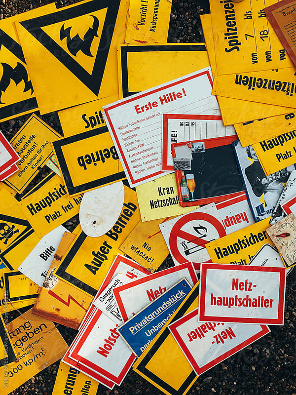 Old Yellow German Signs Overhead by VISUALSPECTRUM for Stocksy United