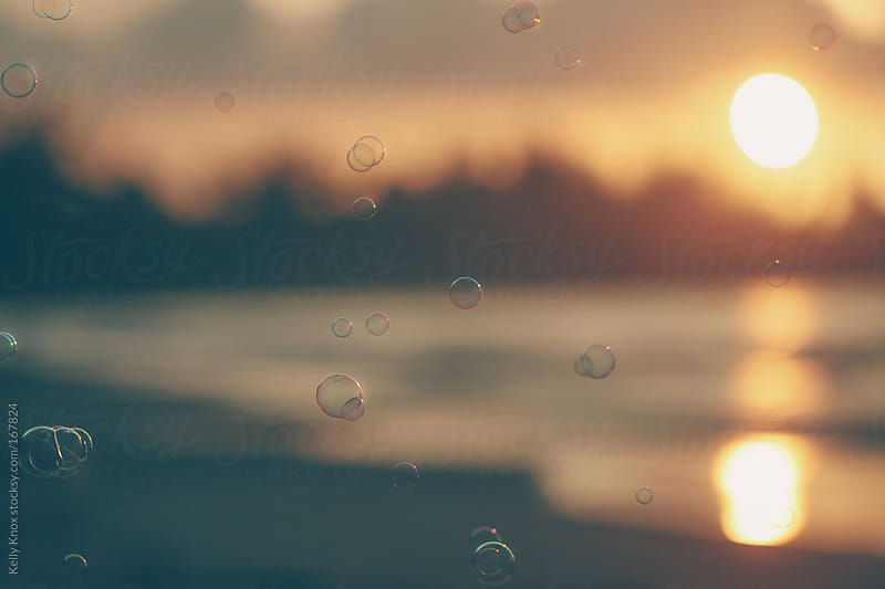 bubbles at sunset by Kelly Knox for Stocksy United
