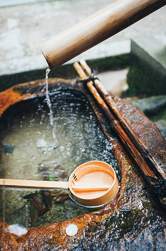 Water-filled basins for worshipper in japanese temple by Chinnaphong Mungsiri for Stocksy United