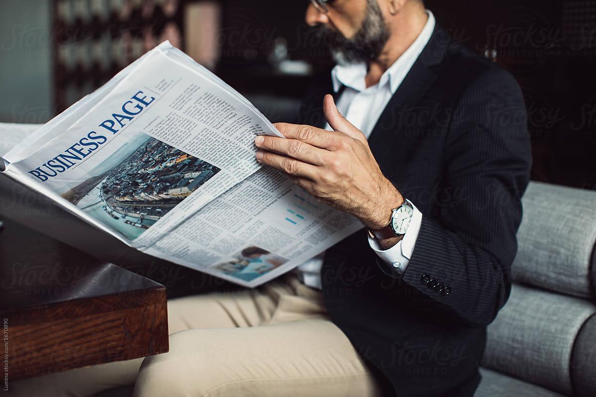 Find a man reading newspaper