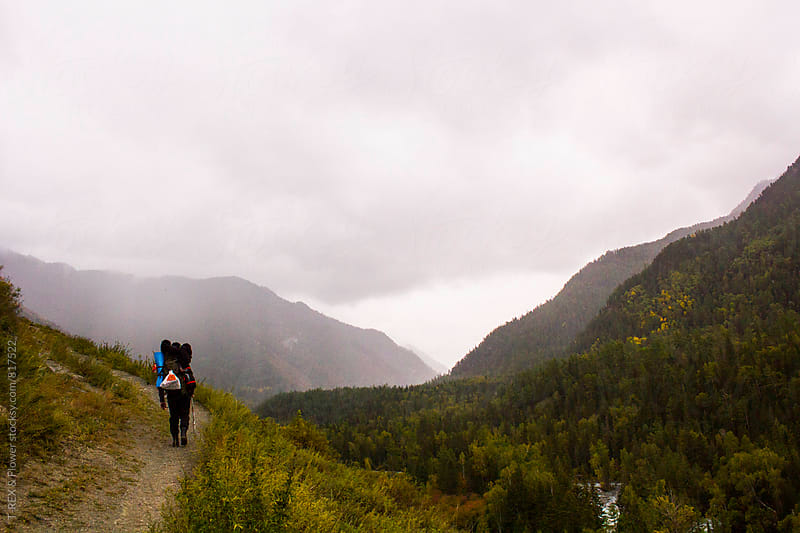 Back view of one man walking on path in the mountains.  by Danil Nevsky for Stocksy United