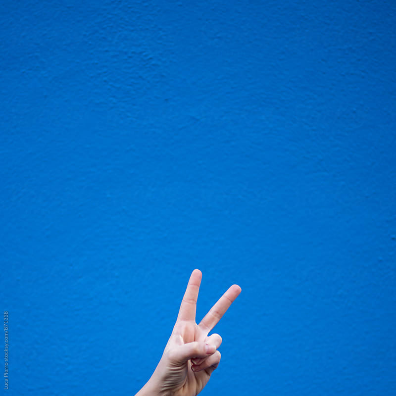 Victory sign made by hand  by Luca Pierro for Stocksy United