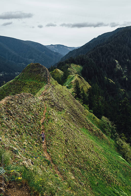 Trail Winding Up Narrow Ridge Mountain Top  by Evan Dalen for Stocksy United