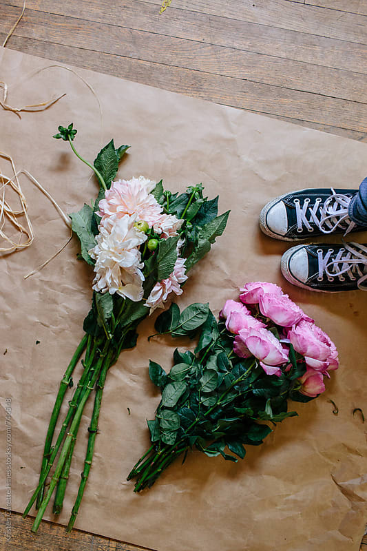 DIY floral arrangement  by Kristen Curette Hines for Stocksy United