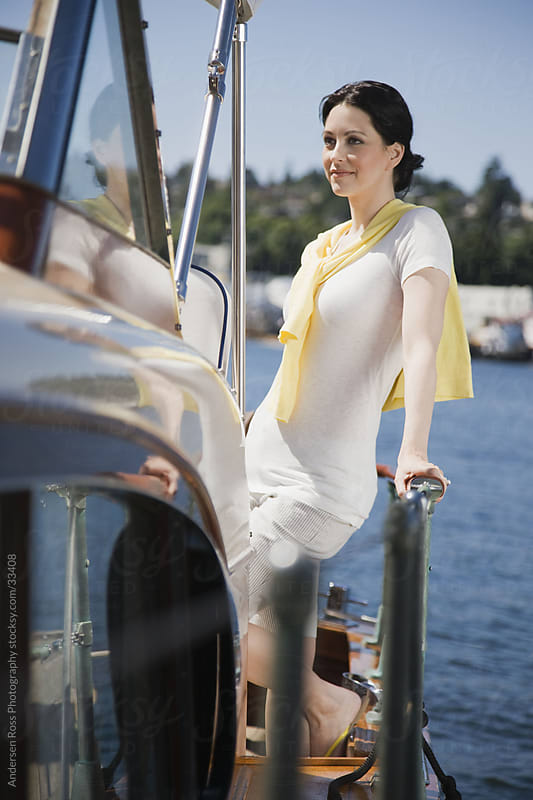 Woman on yacht by Andersen Ross Photography for Stocksy United
