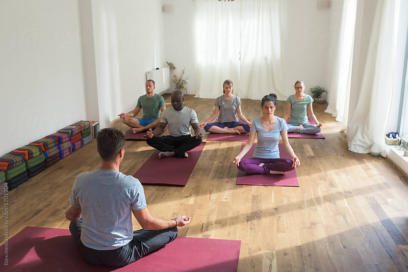 Yoga instructor guiding a meditation exercise