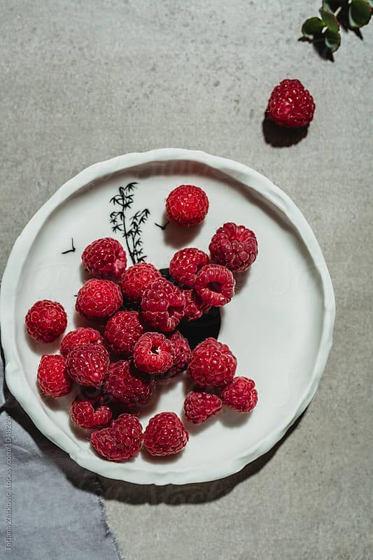 Raspberries by Tatjana Ristanic for Stocksy United