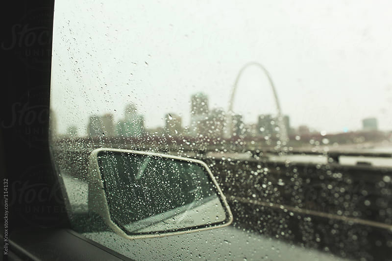 city view through a rainy car window by Kelly Knox for Stocksy United