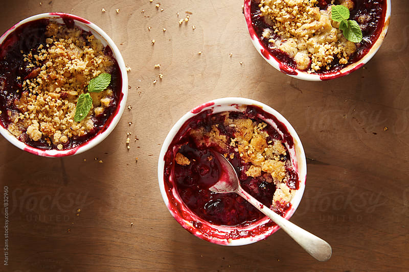 Half eaten berry crumble. by Martí Sans for Stocksy United