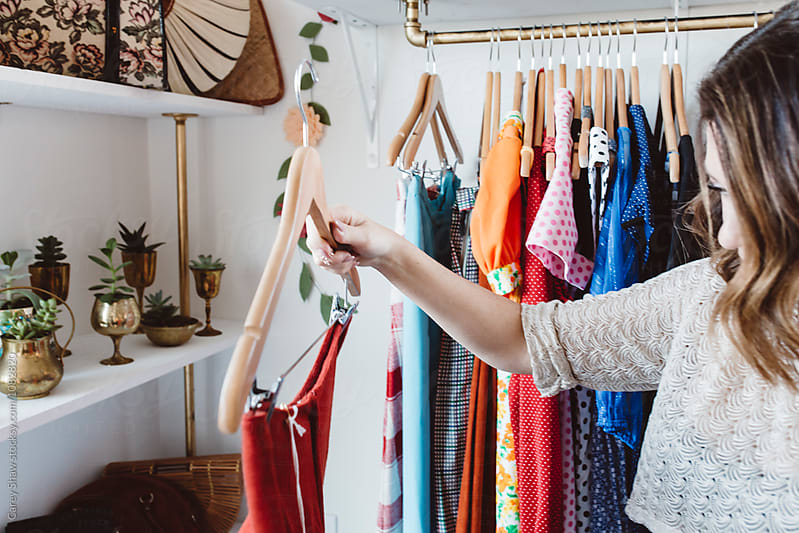 Young woman shopping in cute vintage retail shop by Carey Shaw for Stocksy United