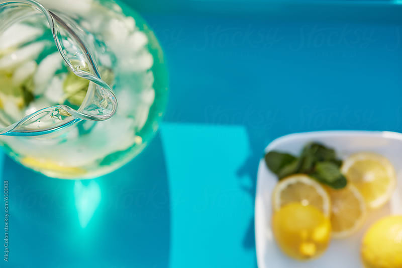 Lemonade pitcher and tray by Alicja Colon for Stocksy United