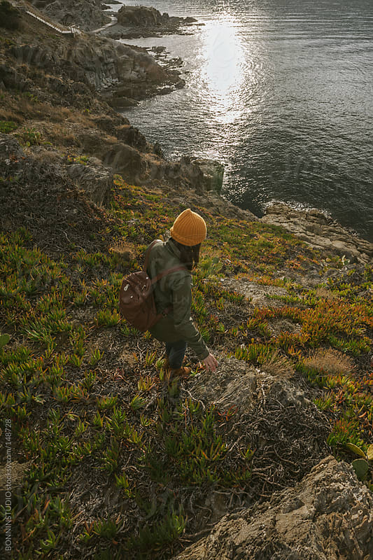 Young hiker woman walking on a cliff. by BONNINSTUDIO for Stocksy United