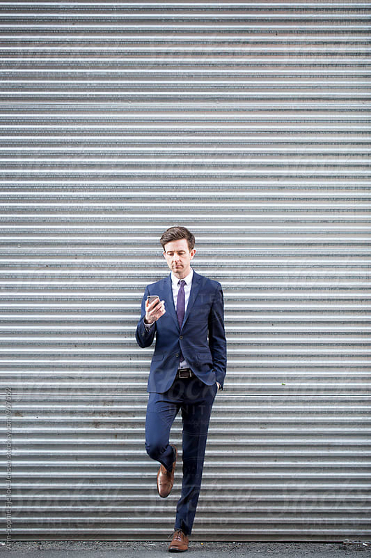 Businessman on his phone  by Ann-Sophie Fjelloe-Jensen for Stocksy United