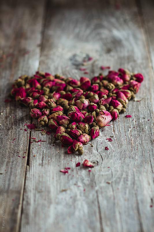 Heart shape made of rose buds by Tatjana Zlatkovic for Stocksy United