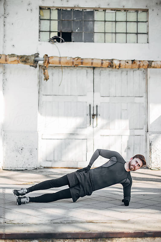 Man exercising outdoors. by Studio Firma for Stocksy United