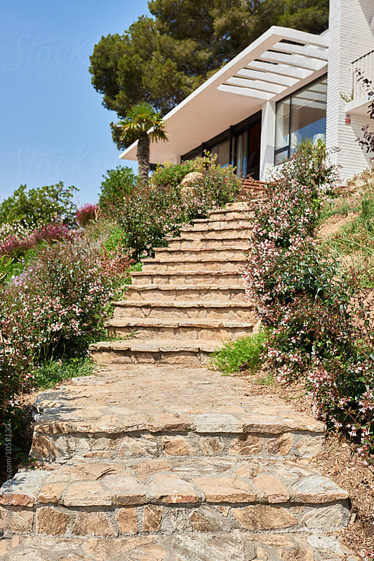 Stone stairway of modern house in garden by Guille Faingold for Stocksy United