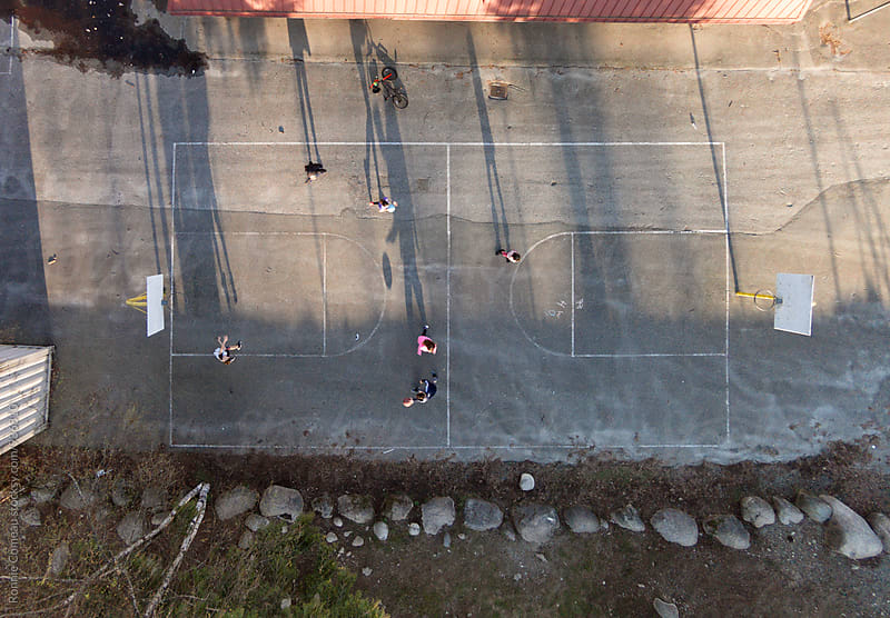 Kids Playing At Playground From Above by Ronnie Comeau for Stocksy United