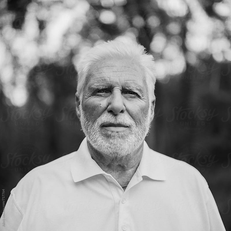Black and white portrait of a handsome older man by Jakob for Stocksy United