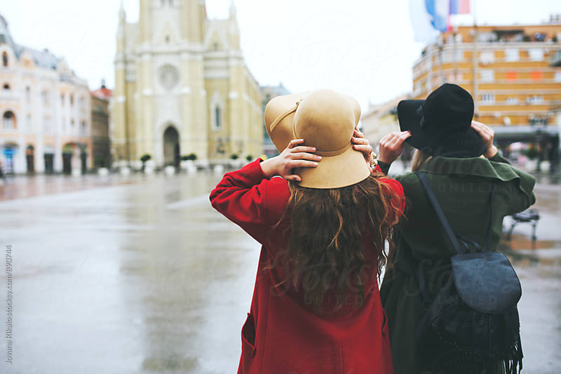 Two fashionable female friends walking on street by Jovana Rikalo for Stocksy United