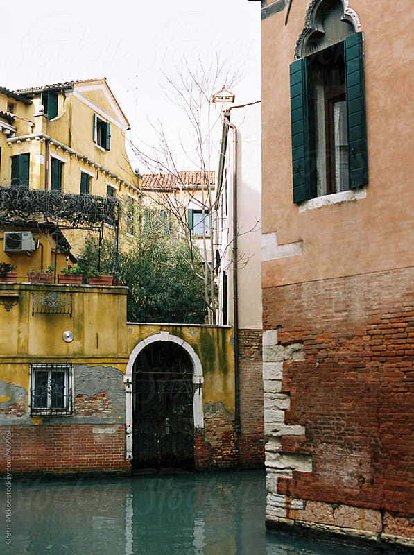 Characteristic orange and yellow buildings in Venice by Kirstin Mckee for Stocksy United