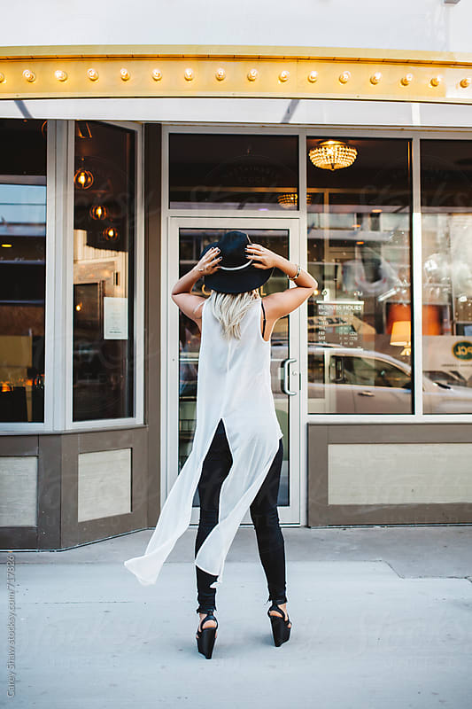 Stylish woman standing in front of building by Carey Shaw for Stocksy United