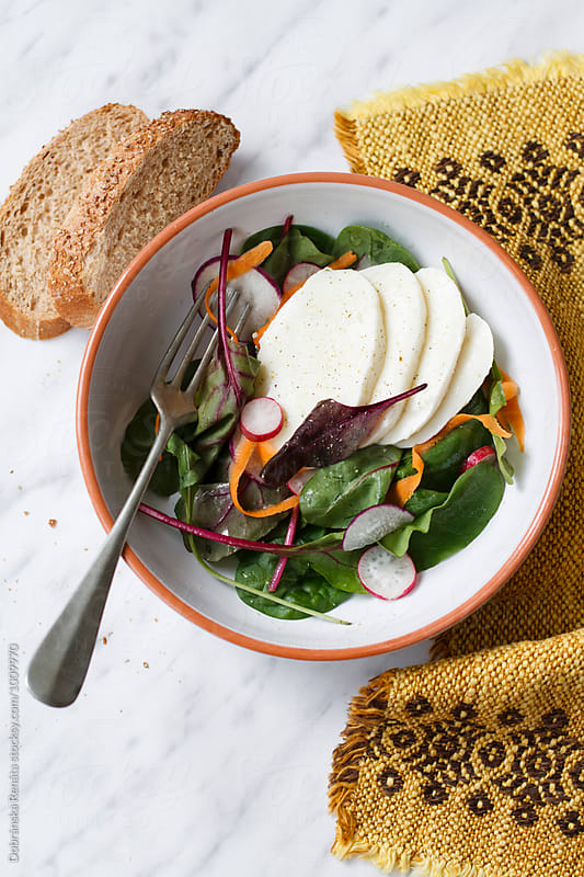 Fresh salad with radishes and mozzarella by Dobránska Renáta for Stocksy United