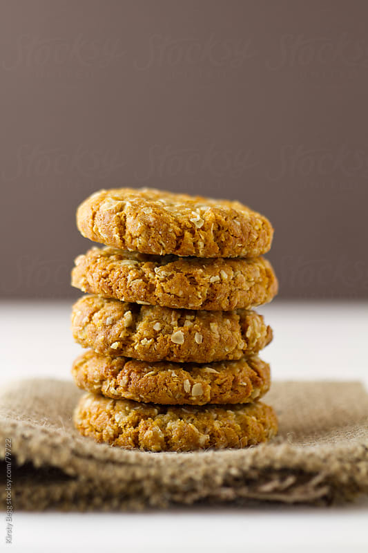 ANZAC biscuits oat cookies in a stack by Kirsty Begg for Stocksy United