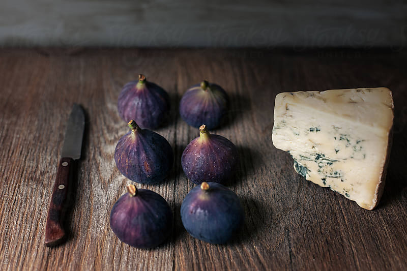 Figs and blue cheese. by Darren Muir for Stocksy United