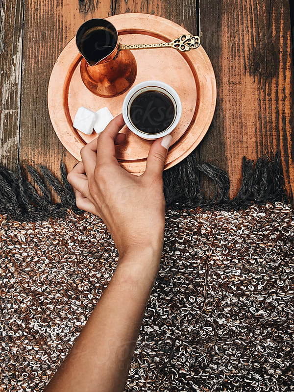 Woman drinking homemade black coffee by Maja Topcagic for Stocksy United