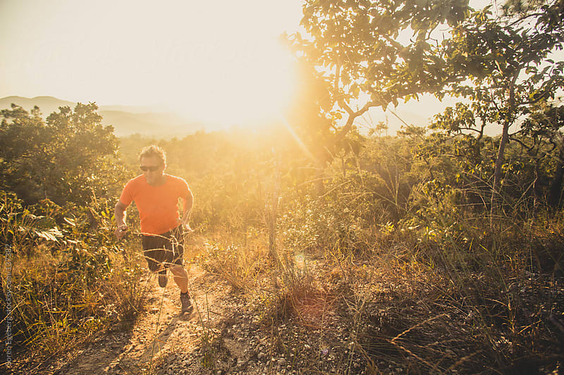 Man sunset running outdoors by Soren Egeberg for Stocksy United