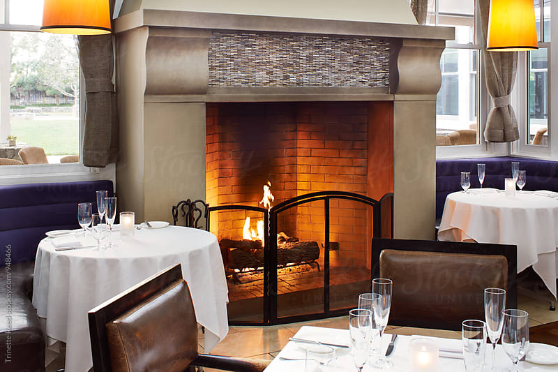 Fireplace in upscale Restaurant by Trinette Reed for Stocksy United