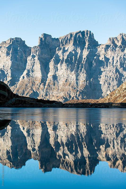 Reflecting mountains by Peter Wey for Stocksy United
