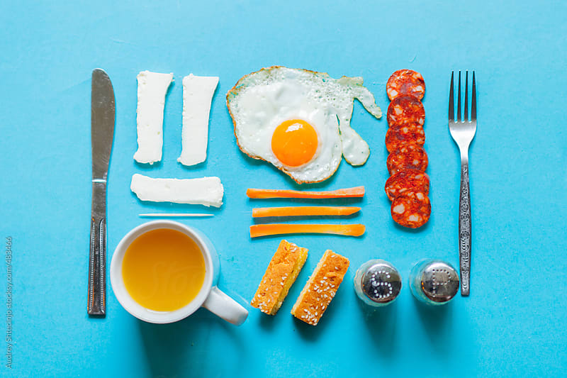 Well organized breakfast food and drink with eating kit. by Audrey Shtecinjo for Stocksy United