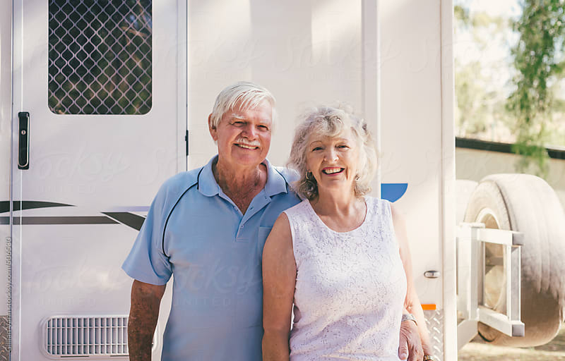 grey nomads, happy retirees with their caravan by Gillian Vann for Stocksy United
